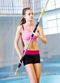 Teen girl pole vaulting — Stock Photo