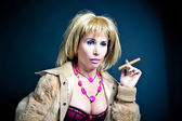 Prostitute smoking over dark background — Stock Photo