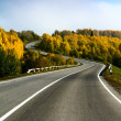 Landscape with road and cloudy sky — Stock Photo