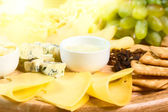Various types of cheese on wooden platter — Stock Photo