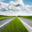 Landscape with road and cloudy blue sky — Stock Photo #13340829