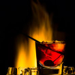 Cocktail with fire and an ice — Stock Photo
