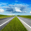 Landscape with road and cloudy blue sky — Stock Photo