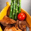 Stock Photo: Stew served with asparagus