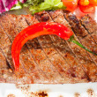Stock Photo: Gourmet grilled steak on a plate