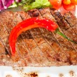 Gourmet grilled steak on a plate — Stock Photo