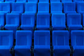 Dark blue rows of theater seats — Stock Photo