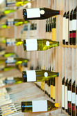 Wine shop, bottles on shelfs — Stock Photo