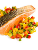 Grilled salmon with vegetables over white dish — Stock Photo