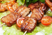 Barbecue with sauce and vegetables — Stock Photo