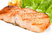 Grilled salmon on white plate — Stock Photo