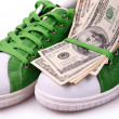 Paper Currency on a green shoes — Stock Photo
