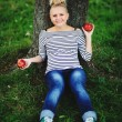 Young pregnant woman sitting under the tree — Stock Photo
