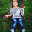 Stock Photo: Young pregnant woman sitting under the tree