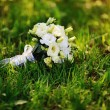 Stock Photo: Bridal bouquet of roses on the grass