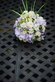 Bridal bouquet of roses and irises — Stock Photo