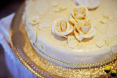 Wedding cake with roses of cream on it — Stock Photo