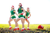 Three beautiful young women wearing santa cloth — Stock Photo