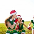 Young girls wearing santa claus clothes — Stock Photo