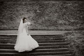 Beautifull bride stands on the stairs — Stock Photo