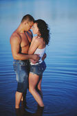 Sweet couple in river bonding — Stock Photo