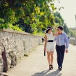 Stock Photo: Heterosexual Couple walking near river