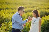 Romantic couple having fun in the field — Stock Photo