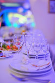 Served table in ultraviolet light — Stock Photo