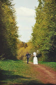 Married Couple walks away — Stock Photo