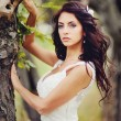 Beautiful bride  in forest - Stock Photo