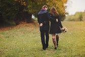 Young couple walking away — Stock Photo
