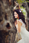 Pretty bride in forest — Stock Photo