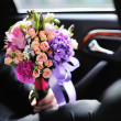 Groom holding Magnificent Bridal Bouquet made of various flowe — Stock Photo #24220253