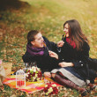 Sweet couple eating candies, having fun — 图库照片