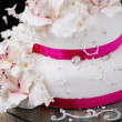 Wedding cake decorated with creamy flowers - Stock Photo