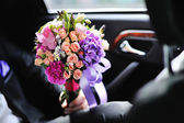 Groom holding a Magnificent Bridal Bouquet made of various flowe — Stock Photo