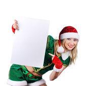Cute young woman wearing santa cloth — Stock Photo