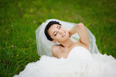 Portrait of young brunette bride in spring garden — Stock Photo
