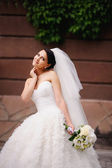 Fashionable stylish brunette bride — Stock Photo