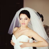 Bride is getting dressed — Stock Photo