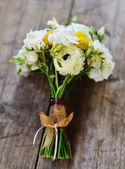 Wedding bouquet with roses and freesia — Stock Photo