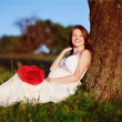 Pregnant woman in summer garden — Stock Photo