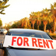 Car for rent in street — Stock Photo #31147929