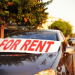 Car for rent in street — Stock Photo #31148429