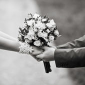 Hands of a weddingl couple in black and white — Stock Photo