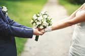 Hands of a newly wed couple together — Stock Photo