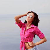 Adorable young brunette in pink — Stock Photo