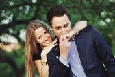 Young sweet couple outside — Stock Photo