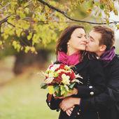 Beautiful young couple having date — Stock Photo