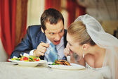 Groom and bride in cafe — Stock Photo